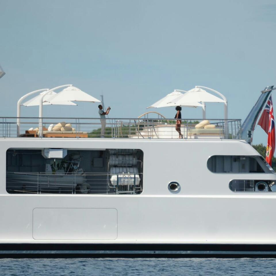 Barack Obama Snaps Photo Of Wife Michelle Obama Aboard A Yacht In The South Pacific