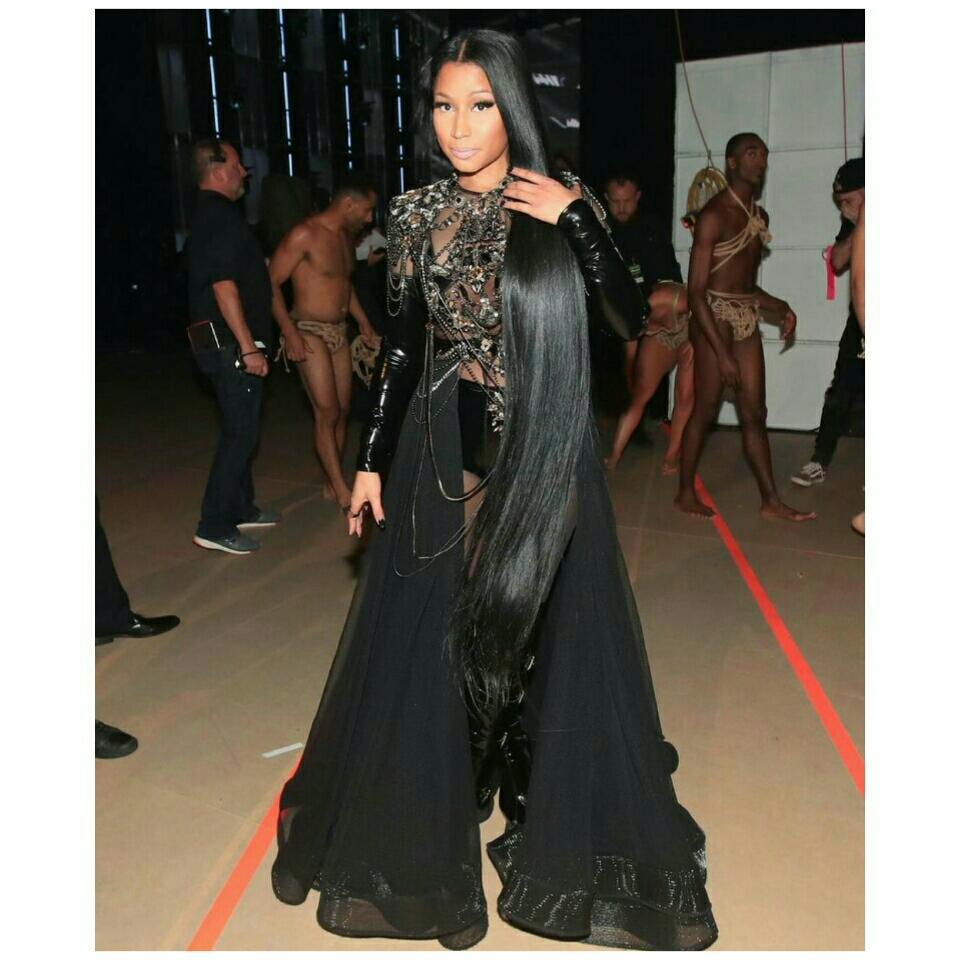 Nicki Minaj Posted Racy Photo Showing Another Woman Adjusting Her Boobs While Modeling Rope Bikini