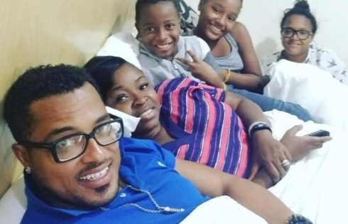Van Vicker And Wife Adjoa Alongside Their Children In Bed Shoot