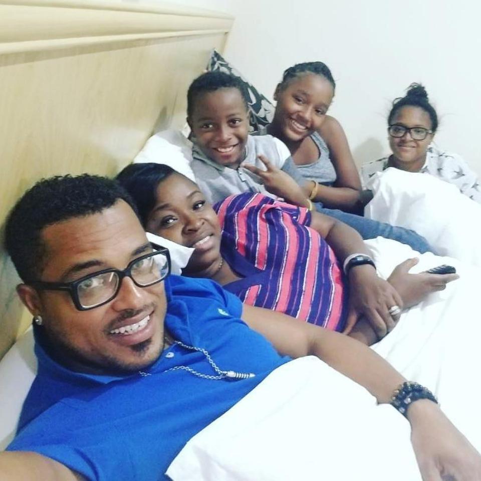 Van Vicker And Wife Adjoa Alongside Their Children In Bed Shoot