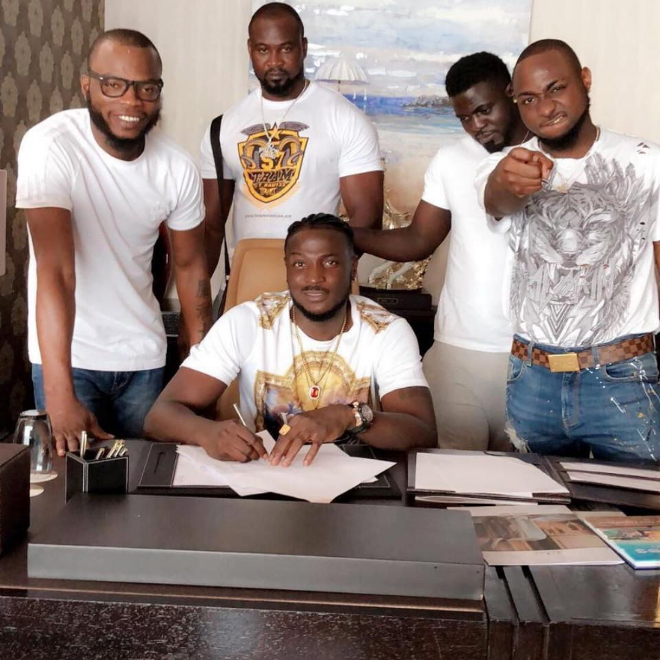 Davido's New Artiste Peruzzio Was Pictured Signing A Blank A4 Paper