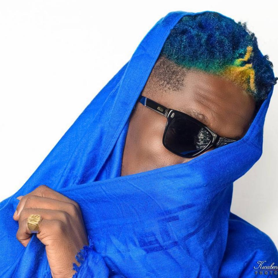 Shatta Wale Unveils New Look With Multi-colored Hair