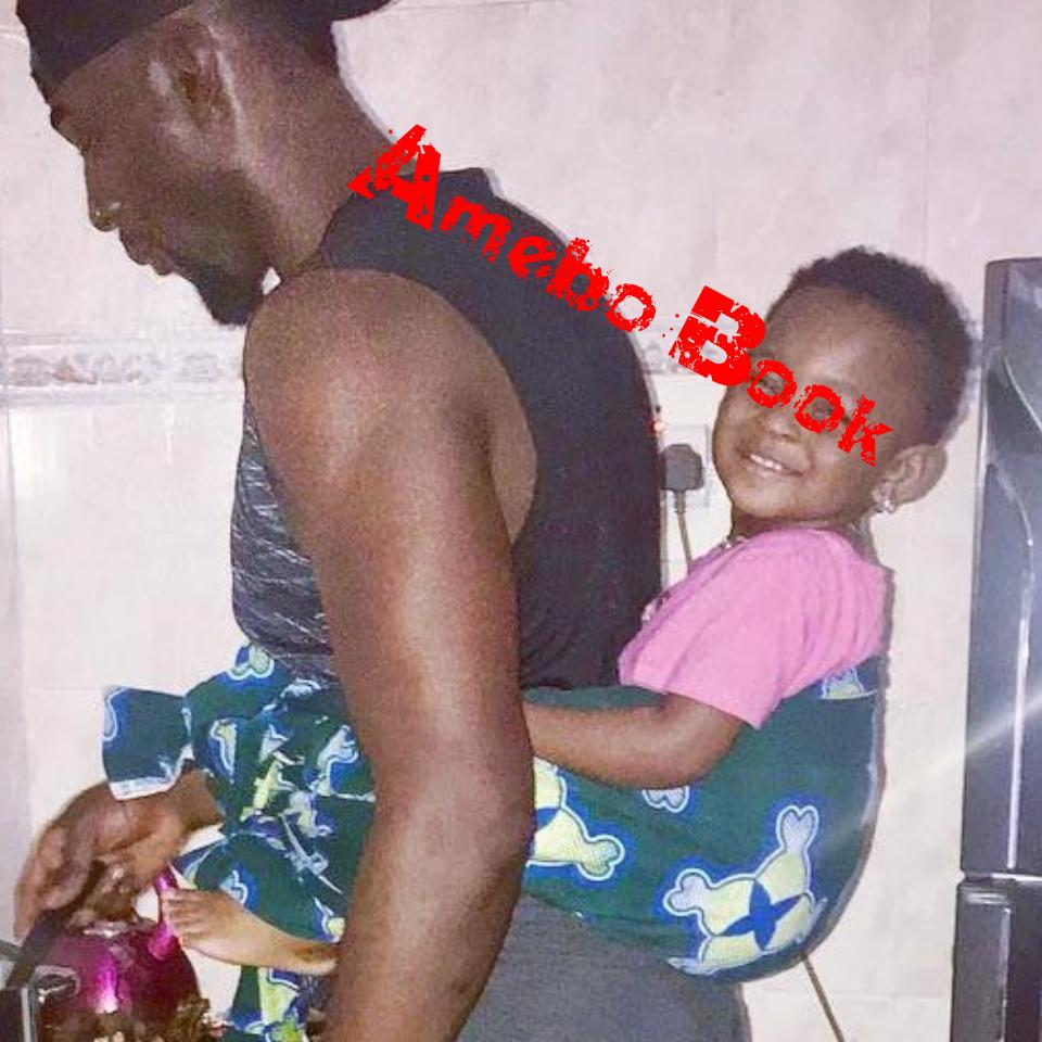Gbenro Ajibade Pictured Cooking With Baby Strapped On His Back