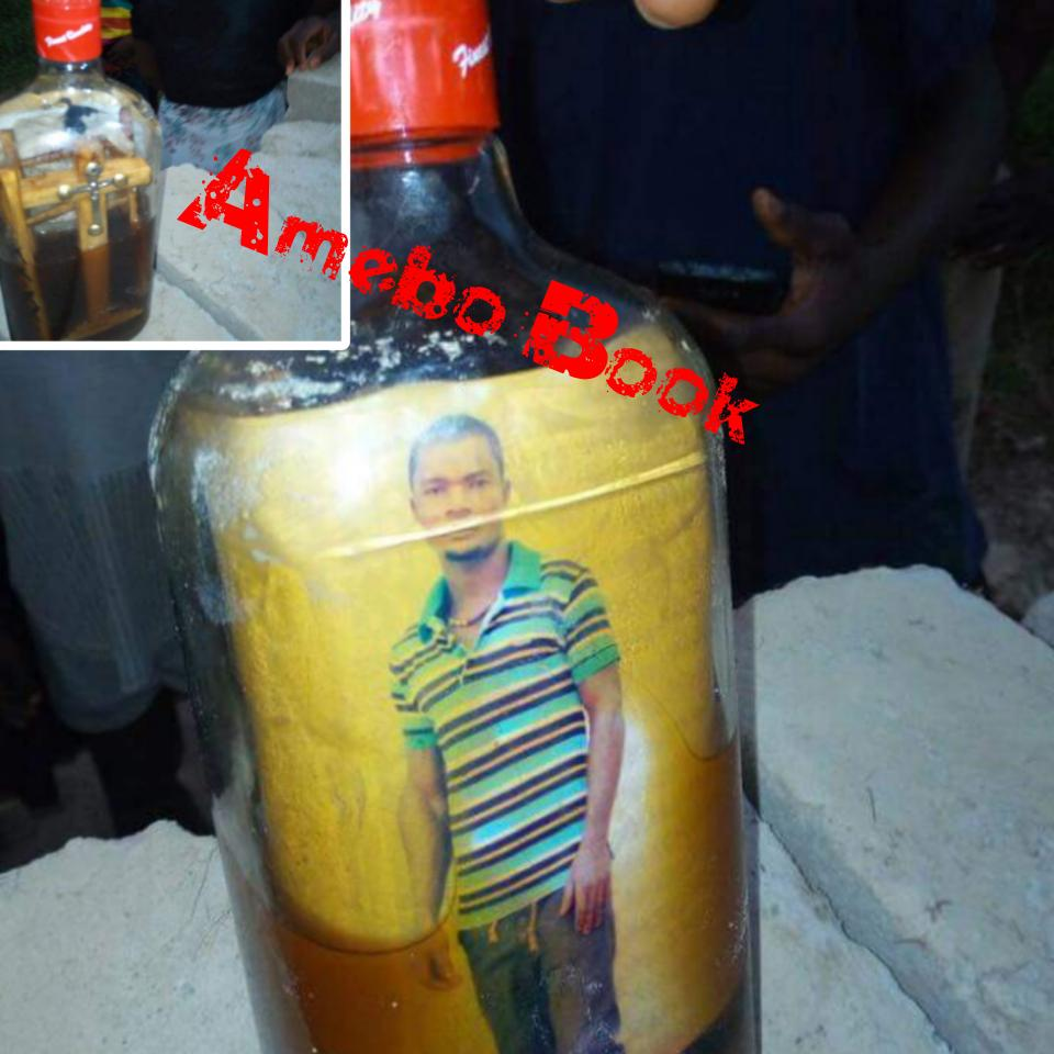 Mysterious Bottle With Picture Of Man And Crucifix
