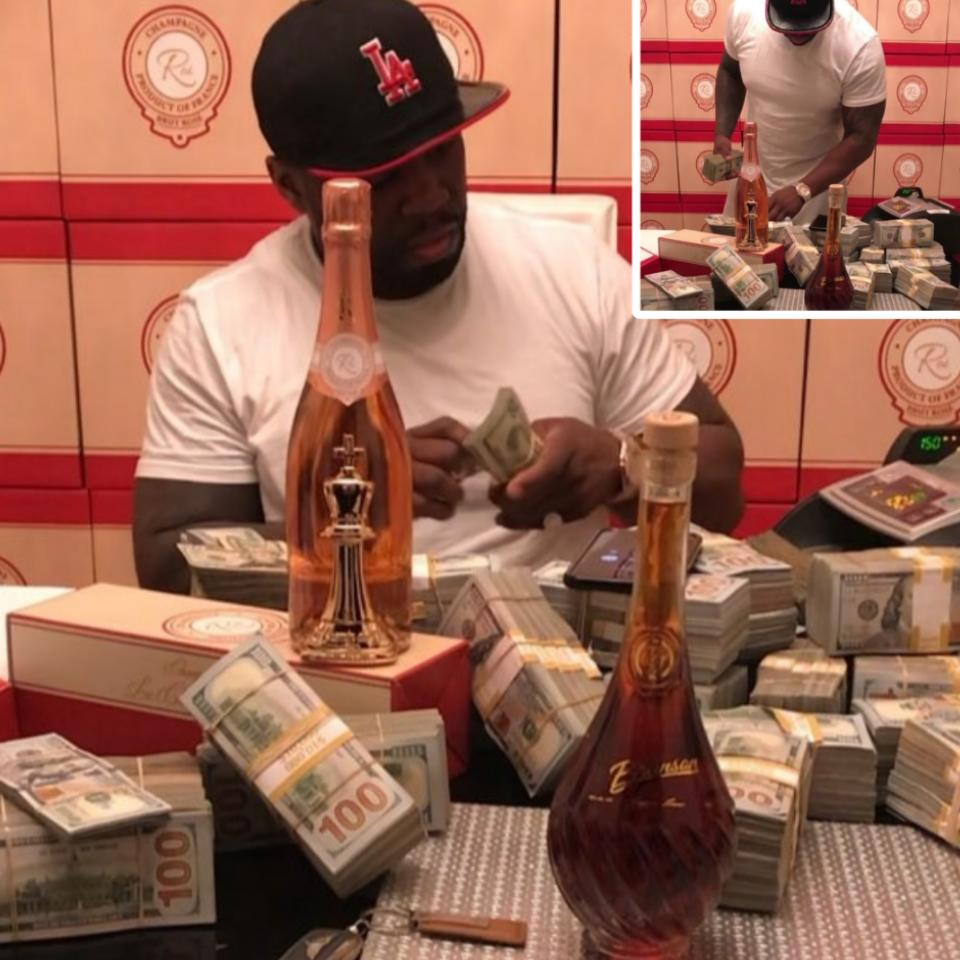 50 Cent Playing Around With Wads Of Cash