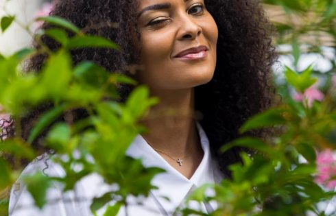 Menaye Donkor's Looks In Long White Shirt And Blue Jeans
