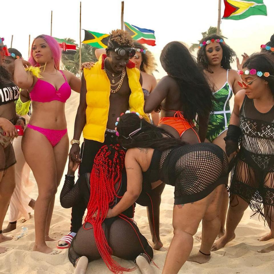 Shatta Wale Surrounds Himself With Bikini Girls In Island Video Shoot