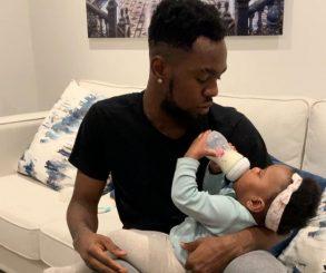 Patoranking Bottle-feeding His Daughter