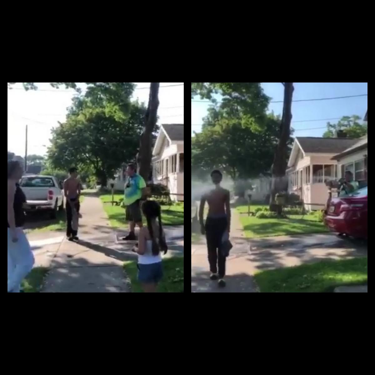 Racist White Man Spraying Black Teen With Water Hose