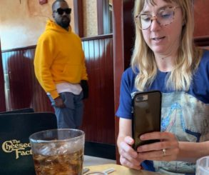 Woman Sneaking Photo Of Kanye West At The Cheesecake Factory