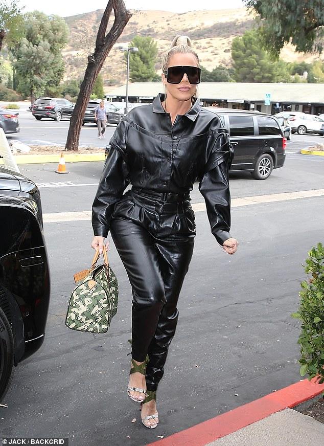 Khloe Kardashian Pout In Black Leather Jumpsuit